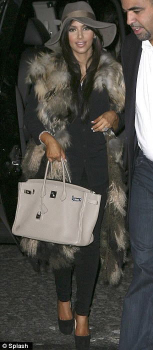 She's at it again: The reality television personality also donned fur on two other occasions that same month
