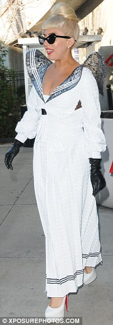 Looking all white: The singer teamed her look with shades and sky high Christian Louboutin heels