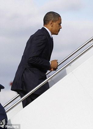 U.S. President Barack Obama steps aboard the Air Force One at Andrews Air Force Base near Washington December 23, 2011