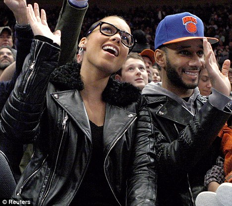 All smiles: Singer Alicia Keys attended the game with her husband Swizz Beatz