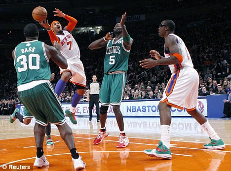 Centre of attention: New York Knicks Carmelo Anthony (2nd L) takes a shot between Boston Celtics Brandon Bass (L) and Kevin Garnett (2nd R)