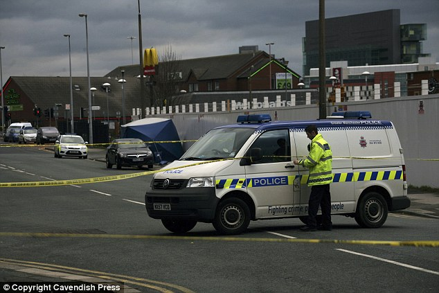 Murder probe: Police cordon off the scene following the random shooting in the early hours of the morning
