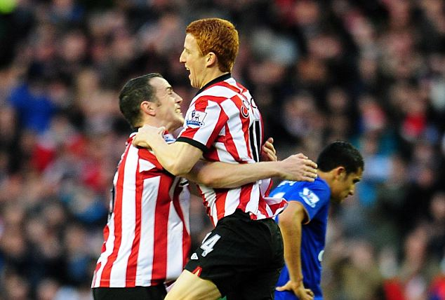 Sunderland's Jack Colback celebrates scoring the opening goal of the game with John O'Shea (left)