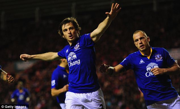 Blue wave: Baines celebrates his penalty strike