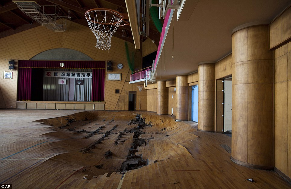 Game over: The damaged gymnasium floor which sank after tsunami waves swept through a school in Namie, Japan on March 11 this year