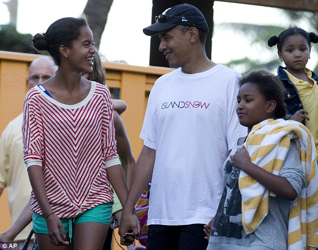 The President, holding hands with his daughters, smiles as Malia, left, cracks a joke. Sasha, however, is only mildly amused