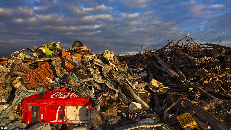 Destruction: Insurmountable heaps of debris cover the contaminated town of Namie which was flattened by the earthquake and tsunami which struck the country earlier this year