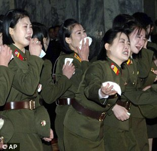 Stricken with grief: North Korean woman in military uniforms weep hysterically over the death of North Korean leader Kim Jong Il in front of his body at the Kumsusan Memorial Palace, Pyongyang