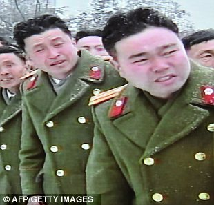 Uncontrollable: Even these mourners in military dress are unable to hold back floods of tears at the loss of the North Korean tyrant