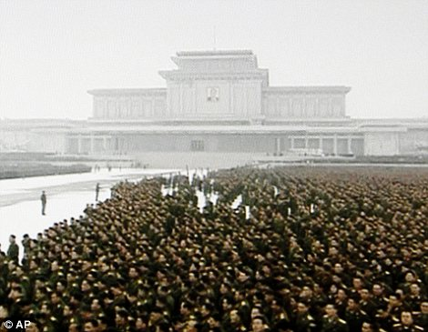 Mass mourning: North Korean military personnel stand in lines during a funeral for late leader Kim Jong Il, in snowy Pyongyang, North Korea
