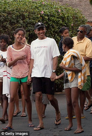 Time to relax: Obama and his daughters released turtles and got the chance to spend some time with friends