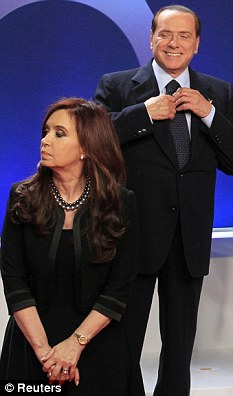 Admirer: Italy's prime minister Silvio Berlusconi adjusts his tie next to Argentina's President Cristina Fernandez during the G20 Summit in November