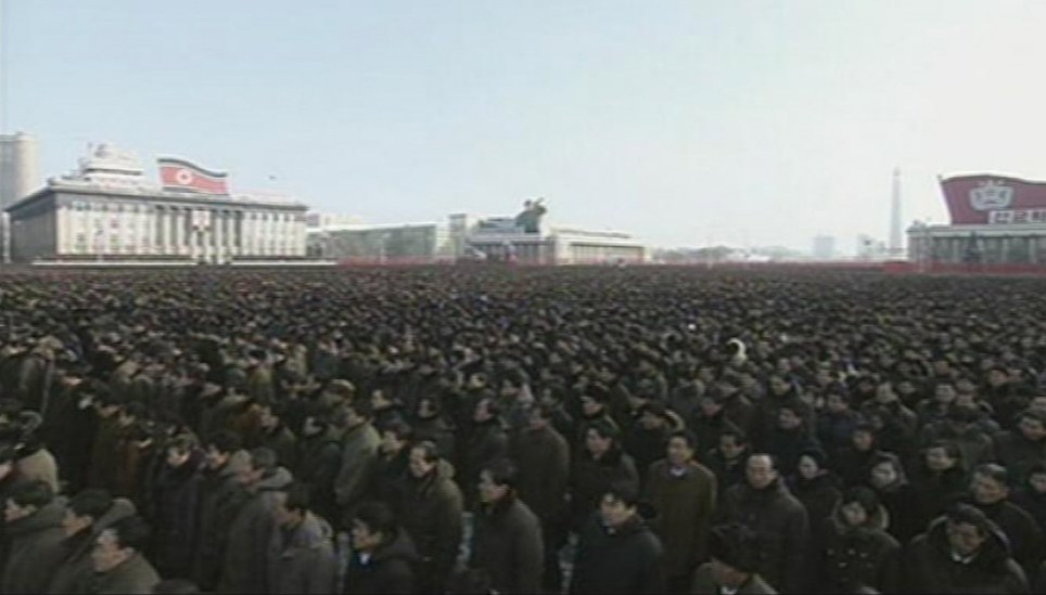 """North Koreans gather during the memorial as the military staged a huge funeral procession on Wednesday in the snowy streets of the capital Pyongyang for its deceased """"dear leader,"""" Kim Jong-il"""