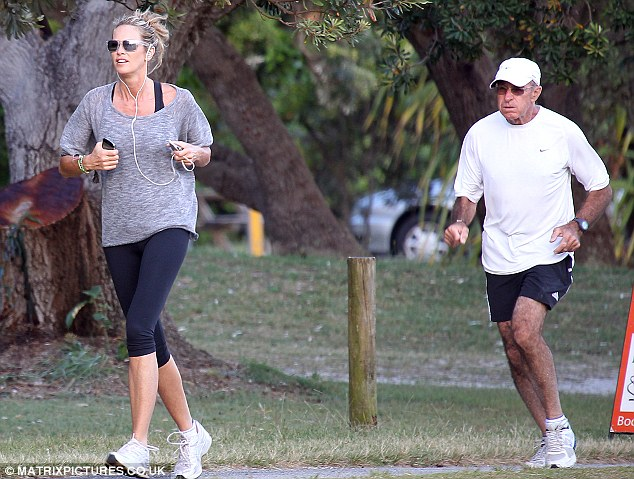 Staying in shape: Elle began her day with an early-morning jog along with her father Peter