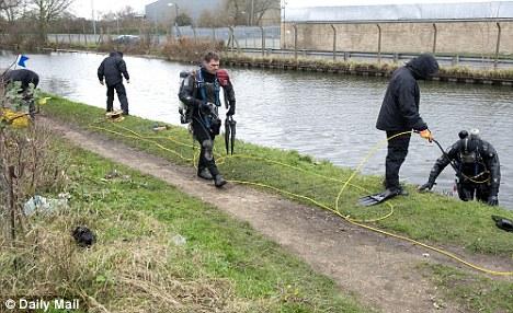 Sealed off: Investigators were still at the scene where Miss Love was found