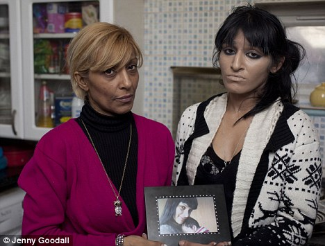Devastated: Ruby Love's mother, Precious, left, and sister Sarah with a photo of Ruby and baby son, Amir