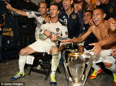 Celebrate good times: Donovan and Beckham with the MLS Cup