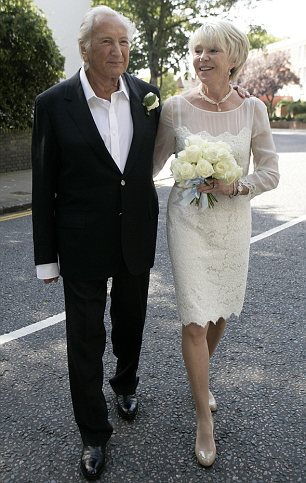 Political union: Ed Milliband's wife Justine Thornton in her Temperley gown (left) and Michael Winner with his wife Geraldine