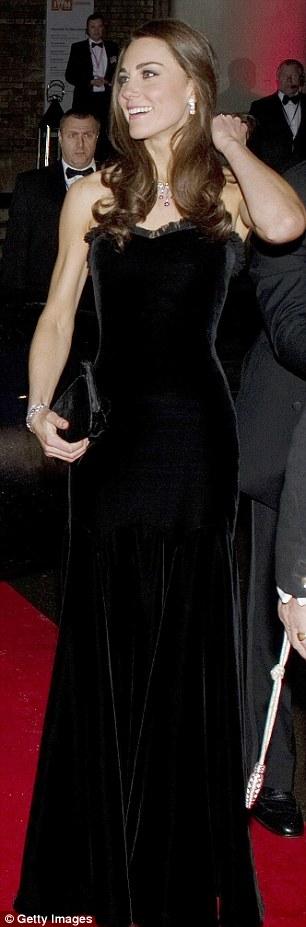 Black velvet gown by Alexander McQueen (£4,000), Pretty Ballerinas velvet clutch bag (£99) - military awards evening, December