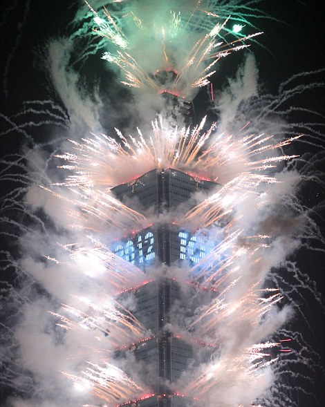Fireworks explode from Taiwan's tallest skyscraper Taipei 101 during New Year