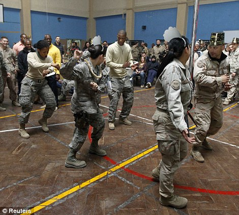 Nato troops from the US led International Security Assistance Force (ISAF) and service members dance during their celebrations