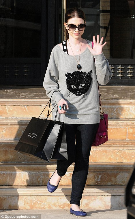 Purrr-fect: Michelle Trachtenberg donned a frisky sweater as she set out for the shops yesterday in Beverly Hills