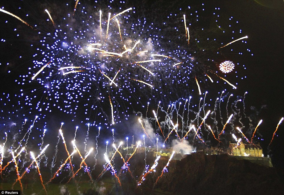 EDINBURGH: Fireworks explode over Ethe Castle during the Hogmanay street party celebrations as the clock hit 12 last night