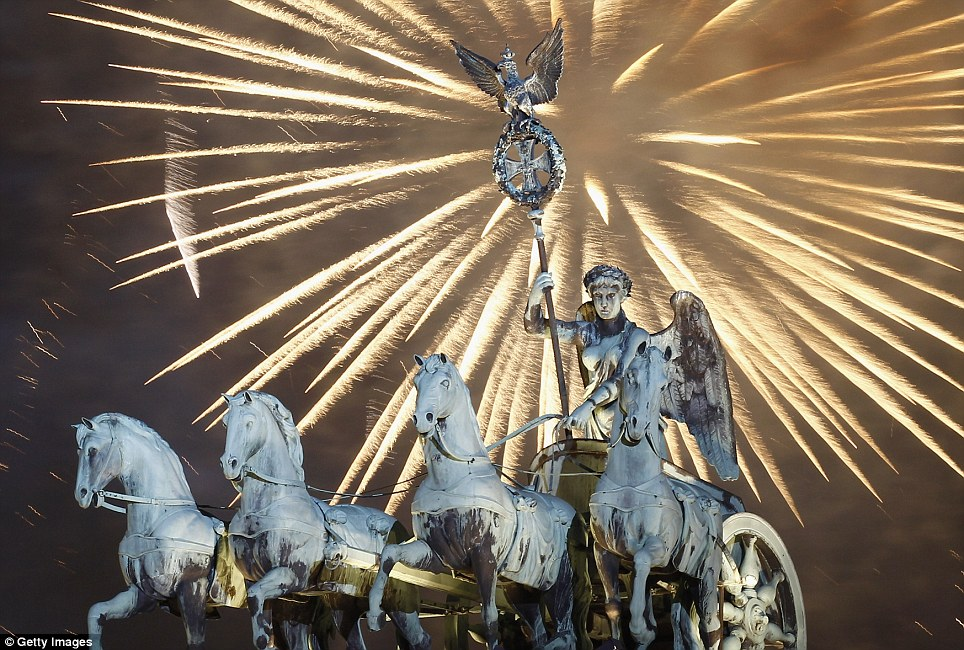 GERMANY: Fireworks explode over the Quadriga statue on top of the Brandenburg Gate in Berlin at midnight