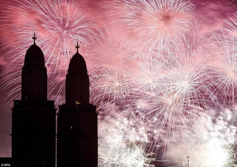 SWITZERLAND: Fireworks light the sky above the Grossmuenster church in Zurich