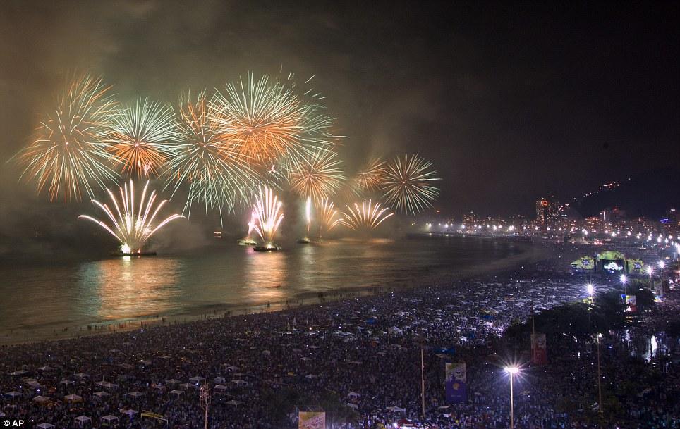 BRAZIL: Fireworks explode over Copacabana beach during New Year celebrations in Rio de Janeiro