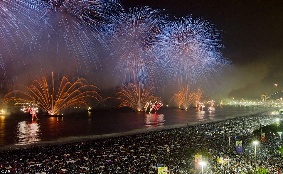BRAZIL: Fireworks explode over the Copacabana during new year beach celebrations in Rio de Janeiro