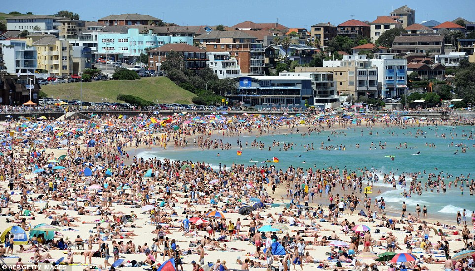 AUSTRALIA: People celebrate New Year's Day on Bondi Beach today only hours after over one and a half million people lined Sydney Harbour vantage points to watch a spectacular pyrotechnic display usher in 2012