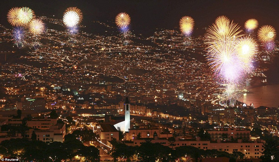 PORTUGAL: Fireworks explode during the year end celebrations over the Funchal city bay in Madeira island