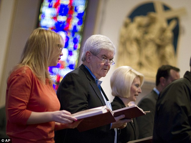 Morning mass: Gingrich looks on during a church service at St Ambrose Cathedral today Des Moines, after which he told reporters Romney would 'buy the election if he could'