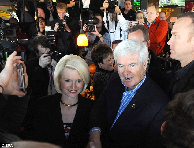 Media frenzy: A new Des Moines Register poll put Gingrich in fourth place, after leading the field a few weeks ago