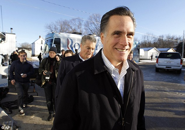 Chief rival : Republican presidential candidate Mitt Romney walks to a television interview following a campaign appearance at the Family Table restaurant today in Atlantic, Iowa