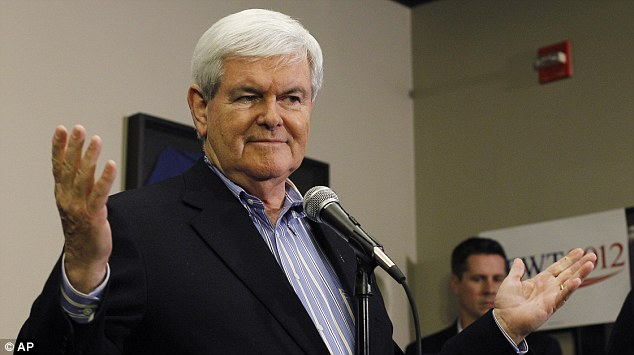 Face-off: Republican presidential candidate Newt Gingrich answers questions during a campaign stop today in Marshalltown, Iowa after launching an attack on rival Mitt Romney