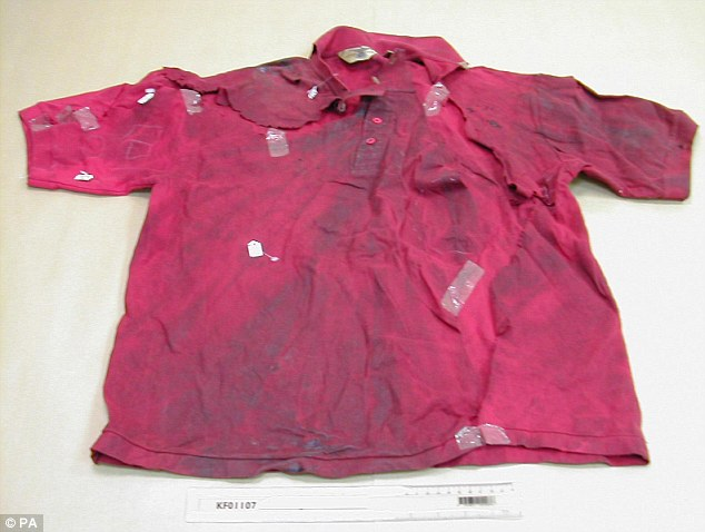 Crucial: Four rare red-orange polyester fibres and seven quite common pink-orange fibres that matched Mr Lawrence's T-shirt (pictured above) - one of which appeared to be bloodstained