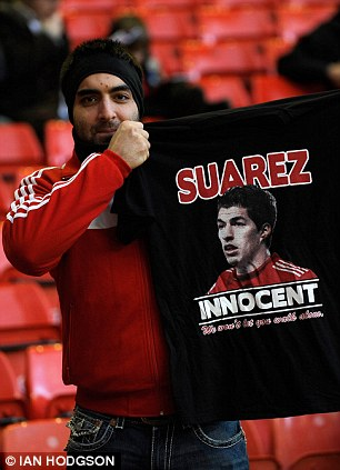 Support: Fans have taken up their club's stance by publicly supporting Suarez