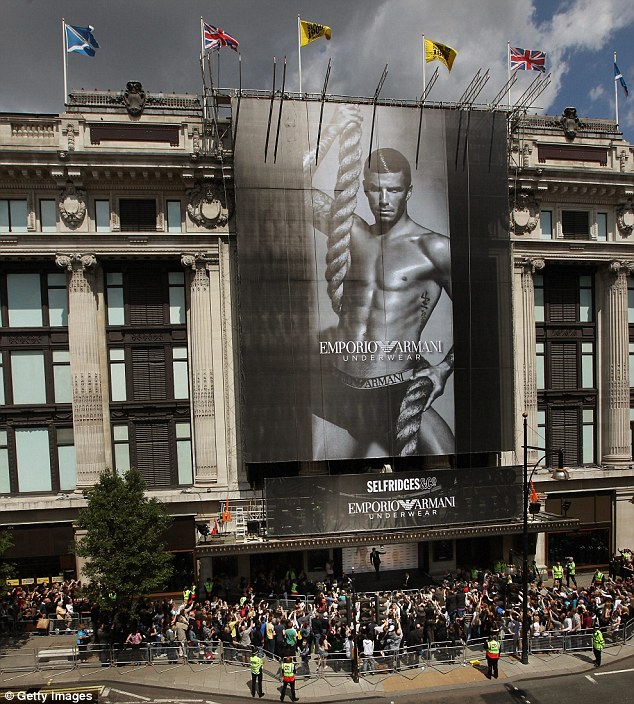 Big hit: Armani's profits doubled following David's campaign which is seen being unveiled here at Selfridges in London in June 2009