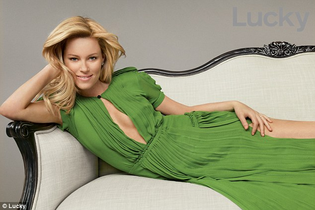 Late to the fashion party: Elizabeth Banks poses for Lucky magazine in a green pleated Georgette Burberry dress