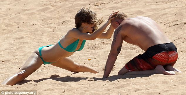 Gladiators: AnnaLynne challenges her man to a wrestle in the sand