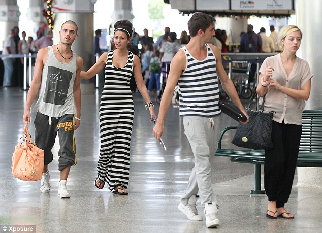 Super symmetry: Tom Parker and his girlfriend Kelsey Hardwick joined the pair for the flight home