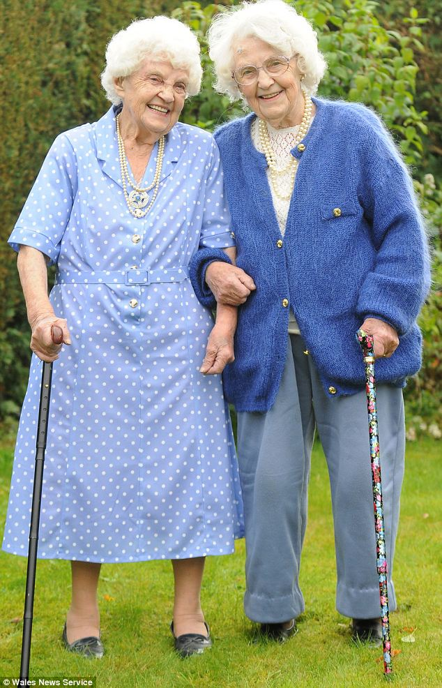 Family life: Sisters Ena Pugh, right, and Lily Millward have celebrated their 102nd birthday today, making them the world's oldest twins. They still talk on the phone every day