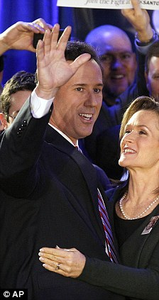 Two winners: Rick Santorum (left) trailed Mitt Romney by only eight votes