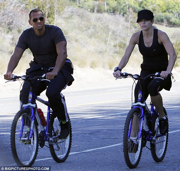 Let's get physical: Alex Rodriguez and new girlfriend Torrie Wilson got all sporty on a bike ride in Los Angeles today as they showed off their matching muscles