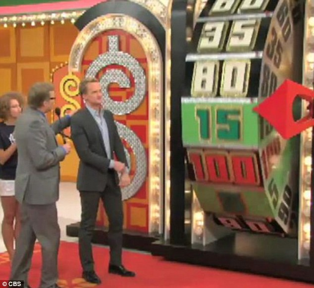 Loving it: Neil got the chance to spin the show's famous wheel as he took part in the special
