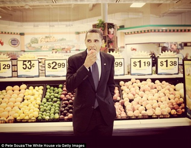 Hey, did you pay for that? President Obama enjoys some fruit in a visit to the supermarket