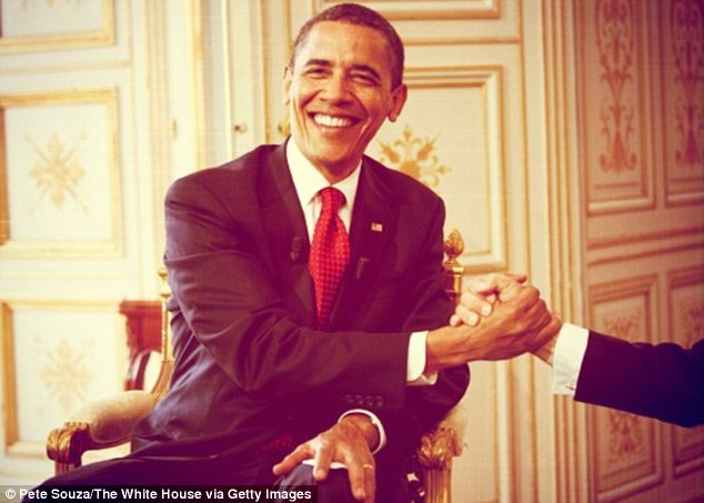 Need a hand? President Obama is all smiles in this classic snap