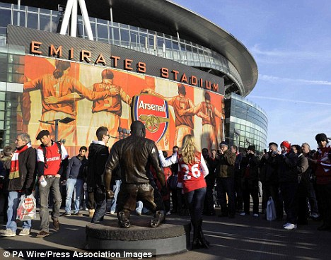 Fans' favourite: Henry has a status outside the Emirates